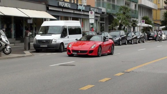 """Do you wanna impress in your stay in Basel? The best way it's to drive a fantastic red car."""